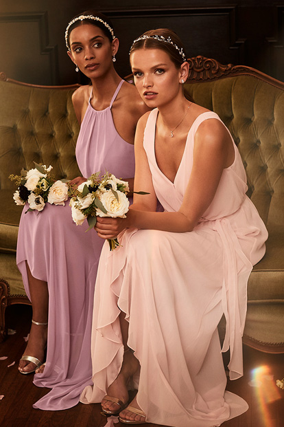 Two bridesmaids wearing pink