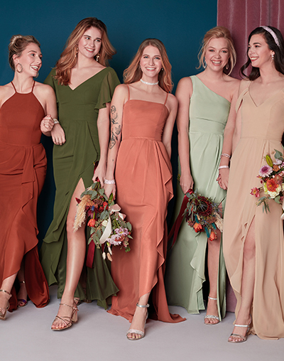 Bridesmaids wearing mix and match wine bridesmaid dresses.