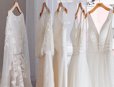 white dresses hanging on a clothing rac