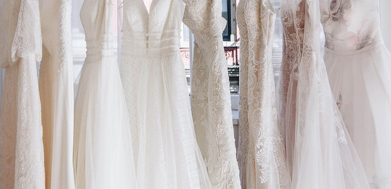 white dresses hanging on a clothing rack
