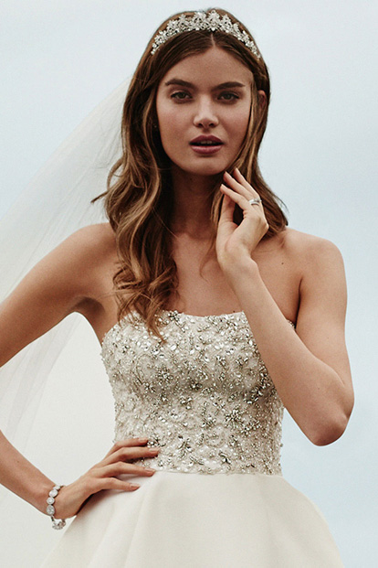 $100 Off Designer Wedding Dresses