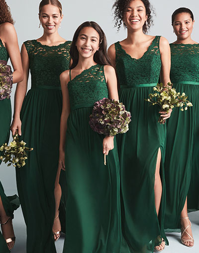 Bridesmaids wearing pink mix and match bridesmaid dresses
