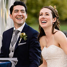 Real Bride and groom laughing at their wedding