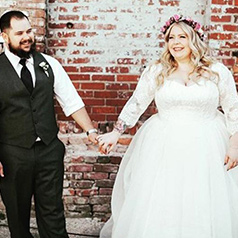 Real Brides and groom holding hands on their wedding day