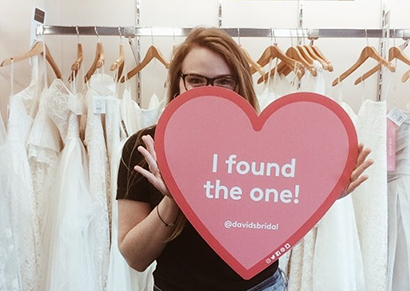 model holding heart that says I found the one.