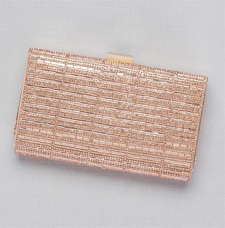 Shiny clutch to wear to a wedding