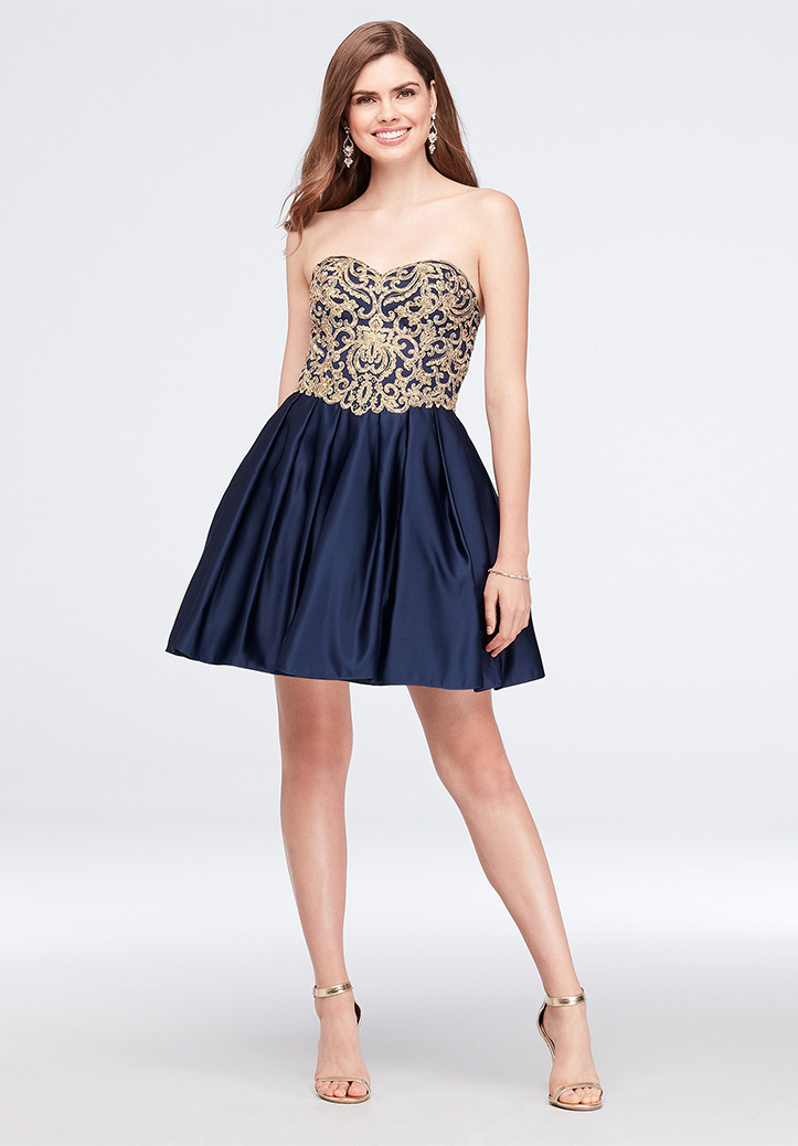 65f9bf00c83 Girl wearing short strapless dress for prom · Shop Dresses