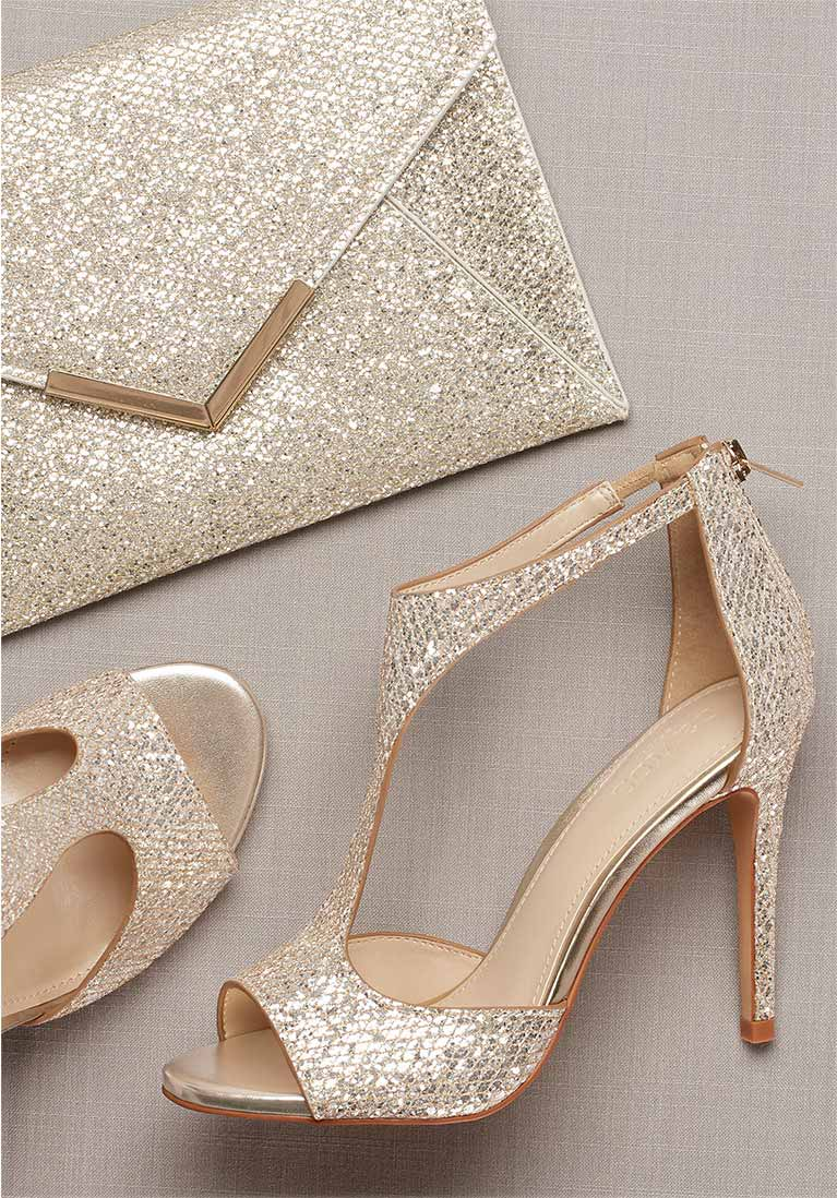 gold t-strap heels and matching handbag