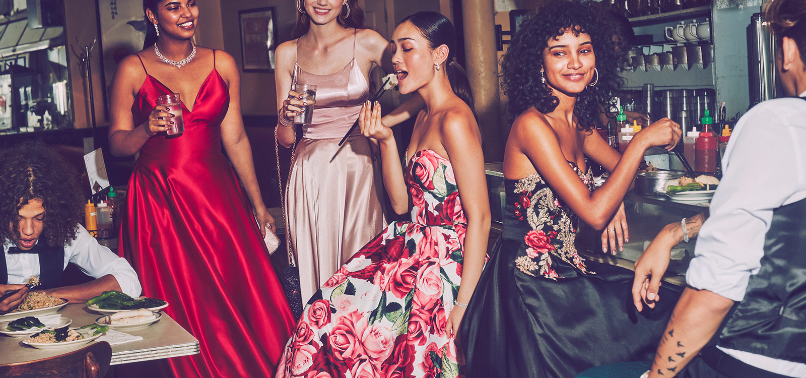 Friends eating together in trending prom dresses