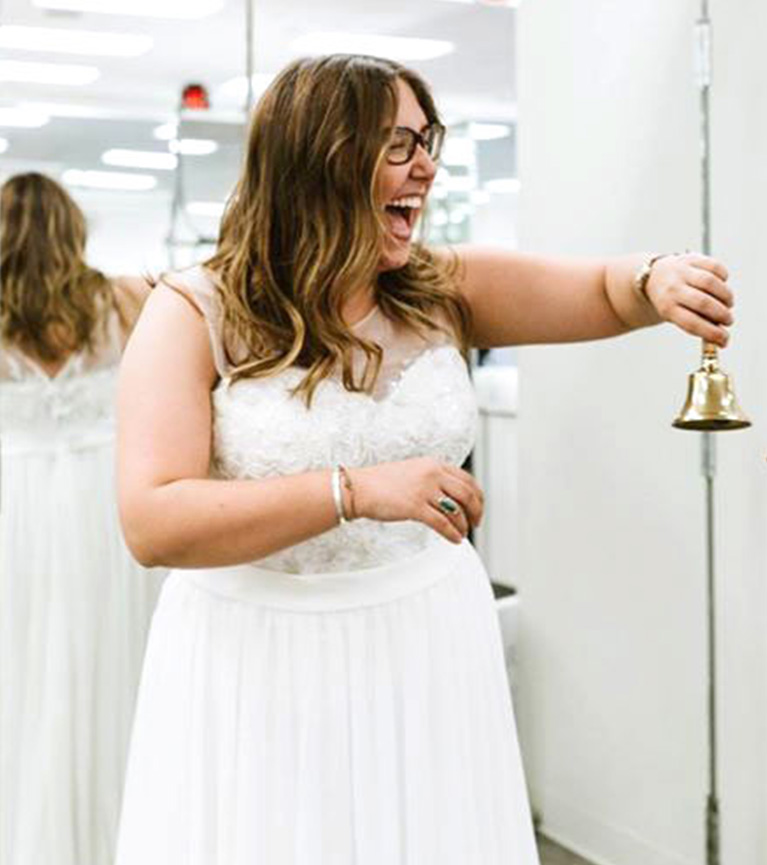 Romantic Elopement in Tennessee | Happy Bride Ringing Bell in David's Bridal Store