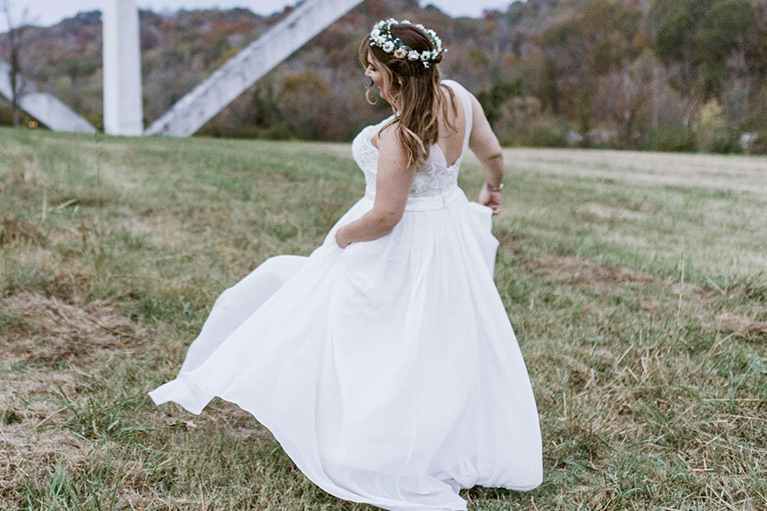 Romantic Elopement in Tennessee | Bride Twirling Wedding Dress in Open Field