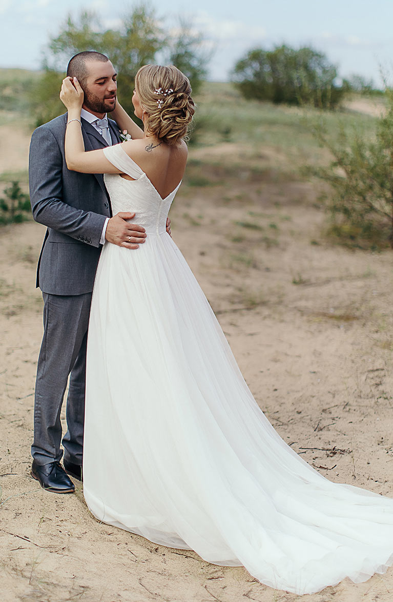 Romantic Beach Wedding | Newlyweds  Holding eachother on the beach
