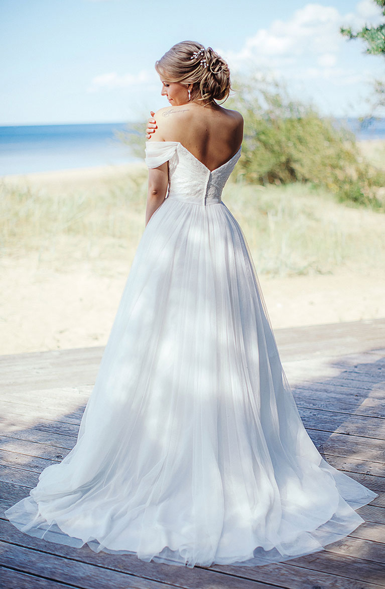 Romantic Beach Wedding | Bride with exposed back  white dress