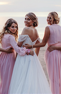 Romantic Beach Wedding | Bride with exposed back  white dress with Pink Bridal Party