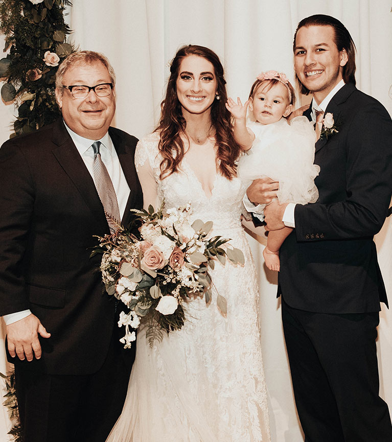 Bride and groom with daughter and father