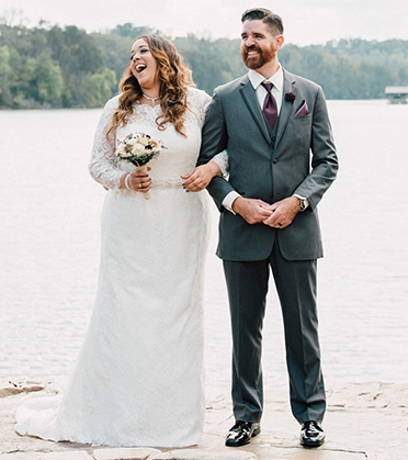Husband and Wife Laughing by Lake | David's Bridal