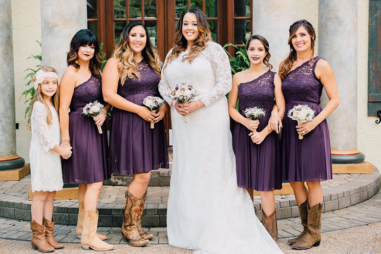Scenic Wedding in Tennessee| Purple Bridal party with the Bride wearing cowboy boots
