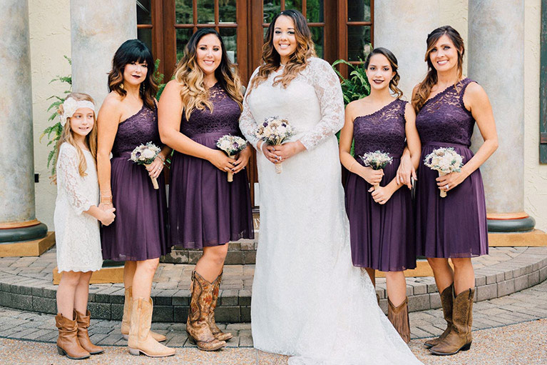 Scenic Wedding in Tennessee | Purple Bridal party with the Bride wearing cowboy boots