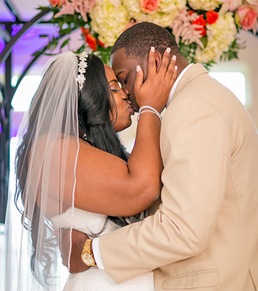 Husband and Wife First Kiss at Altar