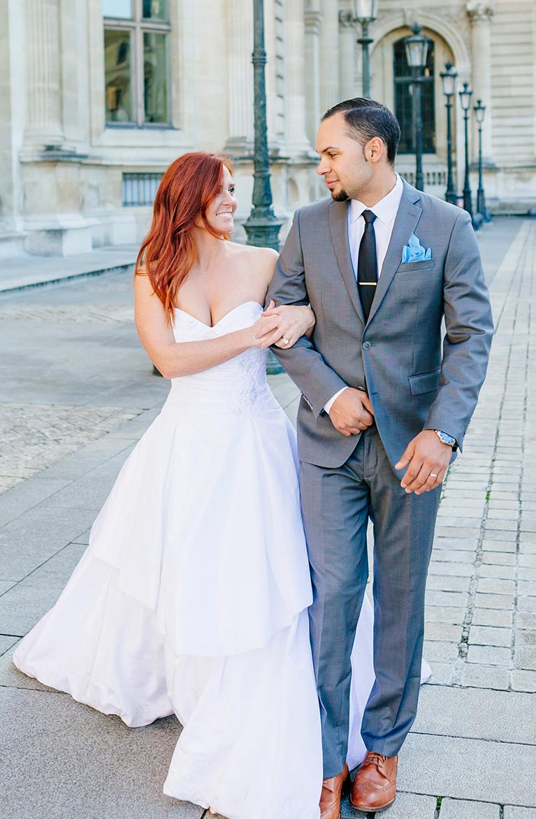 Romantic Wedding in Paris | Newlyweds walking with linked arms