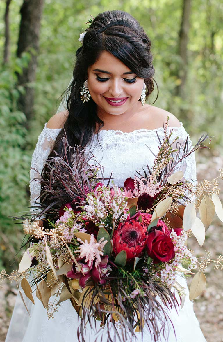 Romantic Fall Wedding | Bride holding flower bouquet