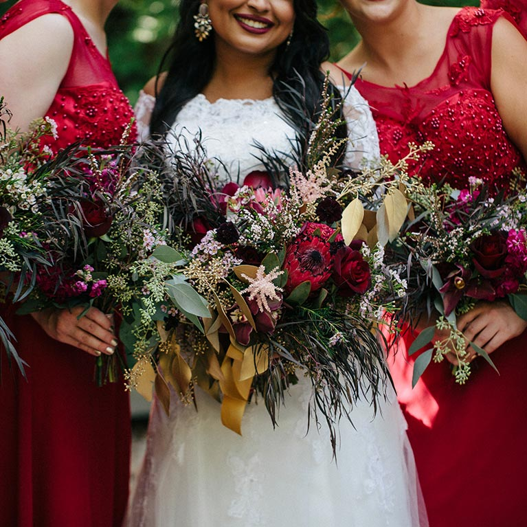 Romantic Fall Wedding | Red Bridal party holding flower bouquets