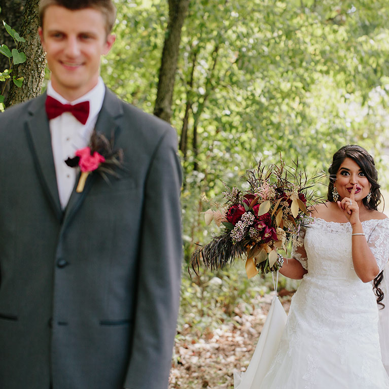 Romantic Fall Wedding | Bride secretly posing behind the husband