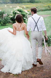 Rustic Summer Wedding | Newlyweds holding hands
