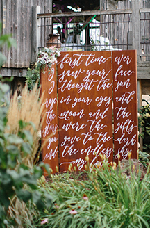 Rustic Summer Wedding | Decorated brown sign with romantic vowels