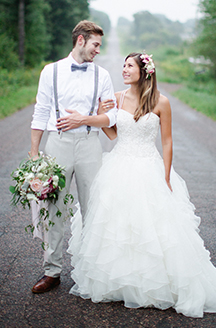 Rustic Summer Wedding | Newlyweds holding eachothers arms
