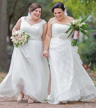 Happy brides holding hands and walking
