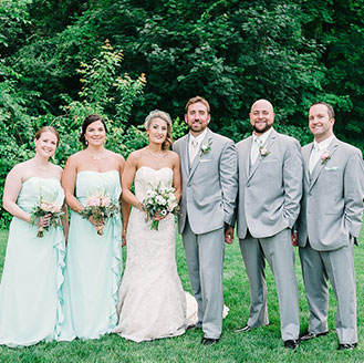Bridal party posing outdoors