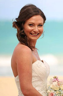 Bride smiling while on the beach