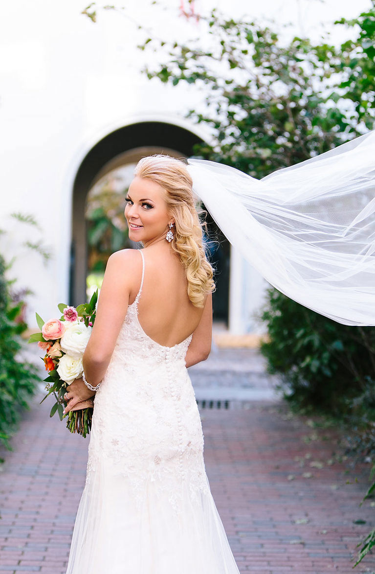 Bride posing while looking back