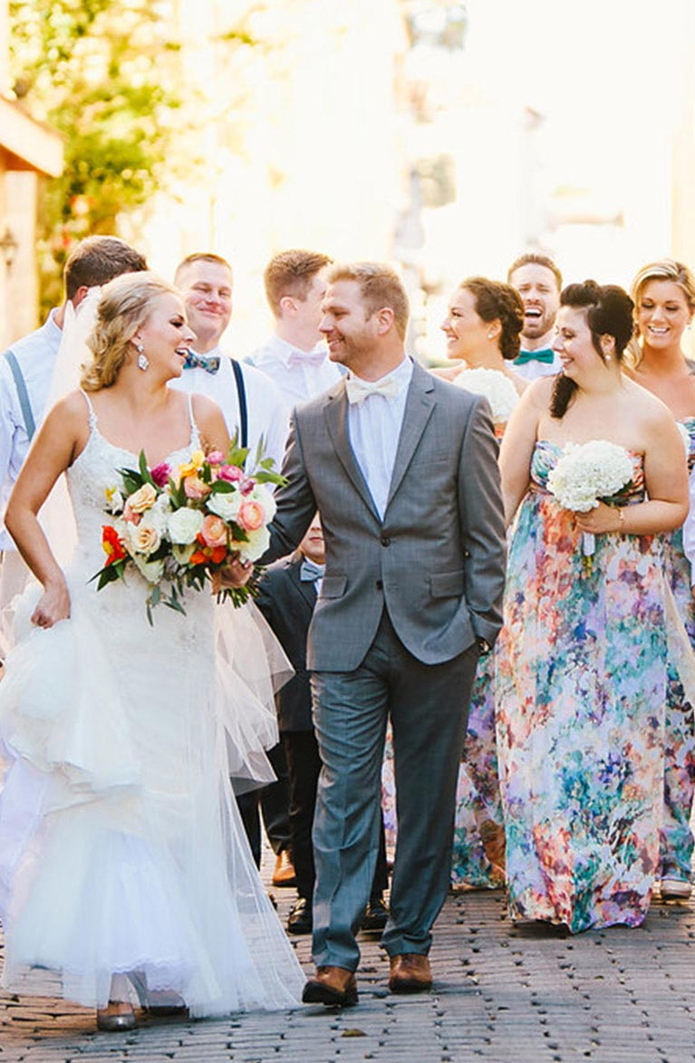 Newlyweds walking in front of the bridal party