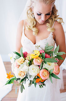 Bride hold the beautiful flower bouquet