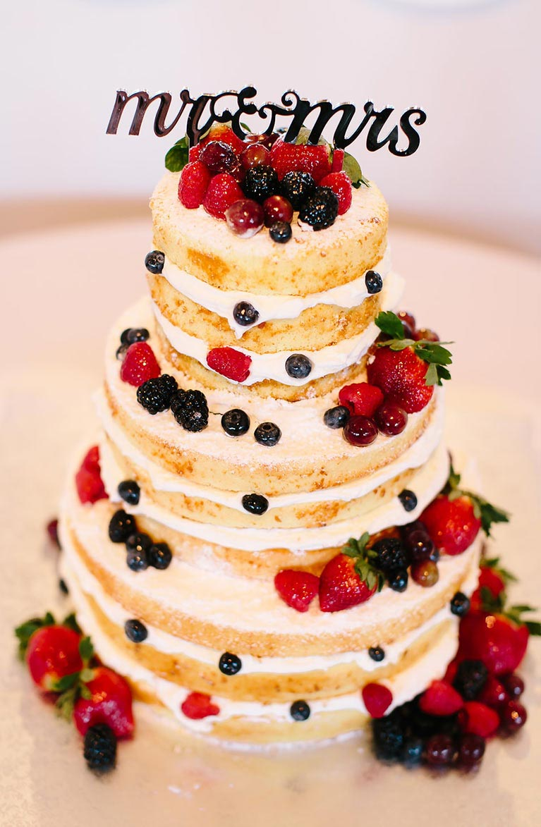 Layered wedding cake with berries