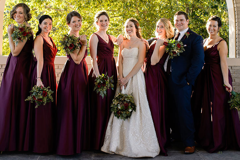 Bride with bridal party wearing wine colored dresses
