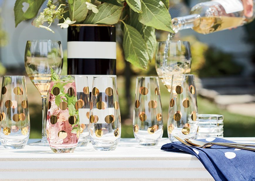 Gold polka dot glassware set on a table outside