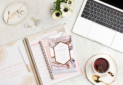 Calendar, computer, and coffee to plan your wedding