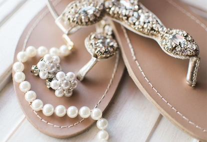 Fancy flip flops and pearl jewelry