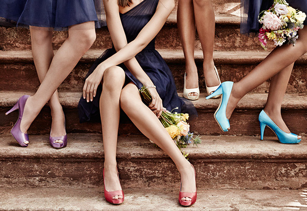 Bridesmaids sitting on a step wearing dyeable shoes