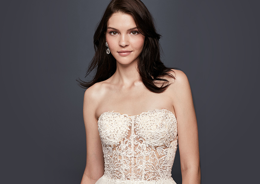 Bride in plunging neckline wedding dress