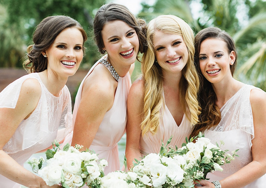 Bridal party wearing different bridesmaid dresses