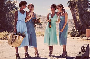 Bridesmaids in blue jumpsuits and floral heels