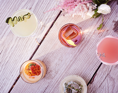 Arial View of Various Drinks on Wooden Table | David's Bridal