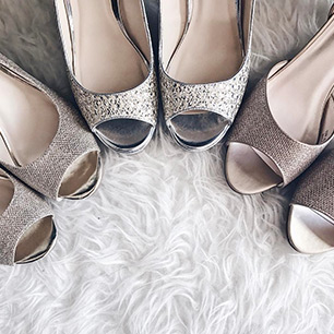 Three pairs of silver high heel shoes
