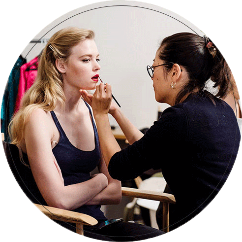 Makeup Artist Applying Shimmering Bridal Glow