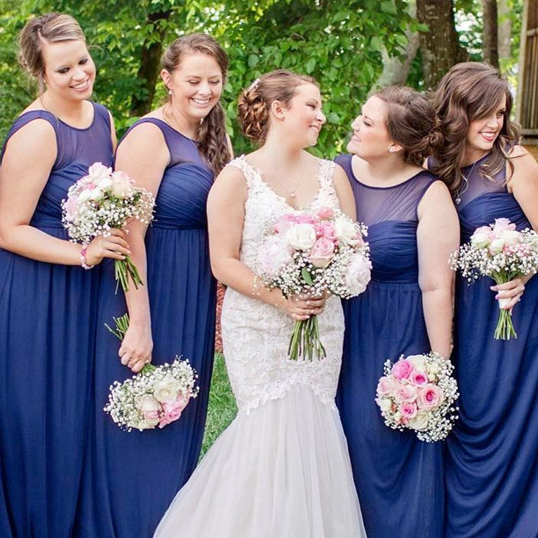 b50408014a4 Bride surrounded by her bridesmaids smiling