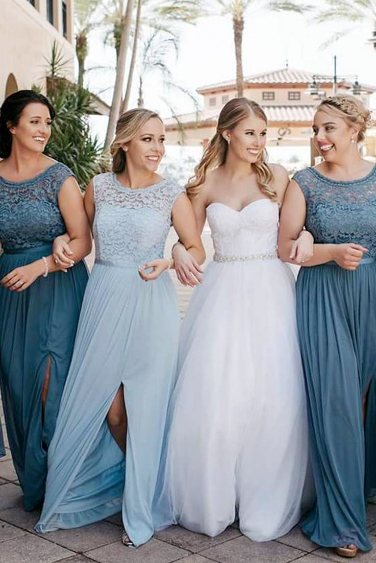 5c0f2ce7e8a Close up of bridesmaids linking arms with bride walking down street